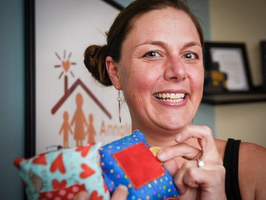 Rebecca Dombrovski, Rice, creates small pillows and