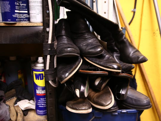 A pile of shoes at C&F Shoe Repair in the City of Poughkeepsie