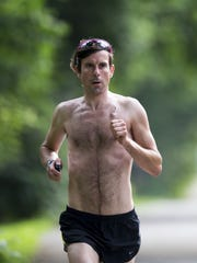 Scott Spitz, an avid runner and strict vegan who has run a 2:25:55 marathon, runs on Indianapolis' tow path, near Butler University, Monday, June 16, 2014. He was diagnosed with two types of cancer in early 2013.
