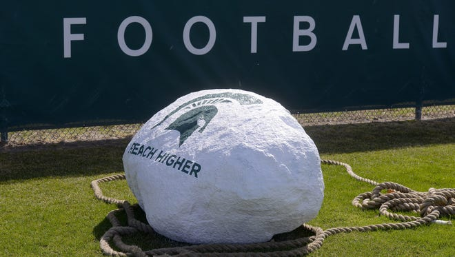The giant inspirational rock on the MSU football practice field during practice on campus in  East Lansing Tuesday   4/14/2015 .