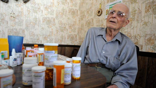 Pierce Ripka, 87, talks Tuesday about being stranded at his Baxter County Road 176 home. Ripka, who takes a number of medications, is worried about getting out because his road had not been plowed as of Tuesday afternoon.