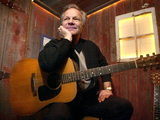 Bobby Vee poses with a guitar in April 2004, at Rockhouse