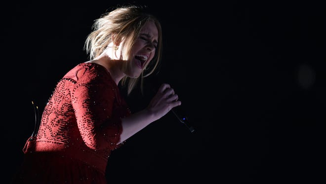 Adele performs during the 58th Grammy Awards at the Staples Center.