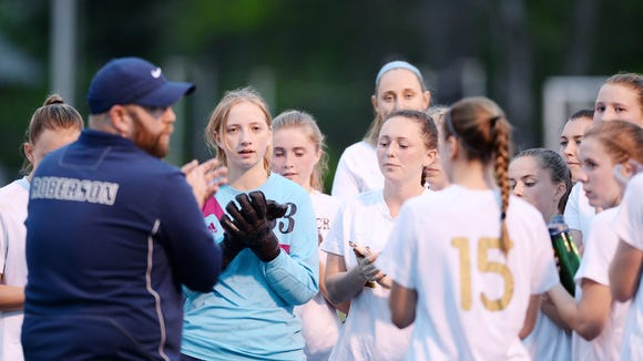 The Roberson girls soccer team and coach Josh Martin.
