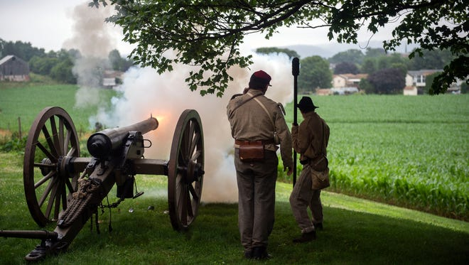A cannon in front of the Mifflin House is fired over the fields, Saturday, June 23, 2018. The reenactment and cannon blasts were to celebrate the Mifflin House's legacy throughout the 1800s. A Civil War Trails sign will soon be placed on Cherry St., in Wrightsville, to commemorate the house.