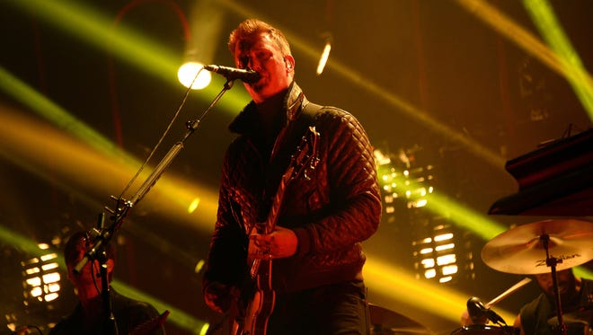 Singer Josh Homme (L) performs with Queens of the Stone Age during the Rock-en-Seine music festival in Saint-Cloud near Paris on August 24, 2014.