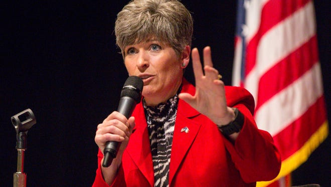 Republican Sen. Joni Ernst, seen here at a town-hall meeting in Fort Dodge, Iowa, on Aug. 14, 2017, will help Sen. Jeff Flake raise money for his re-election campaign.