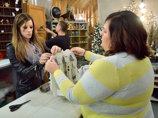 Artists Jenna Schaefer, left, and Megan Rauch work on a jewelry display Tuesday, Nov. 10 at the Copper Pony in rural Clearwater as they get ready for the first of their holiday events of the season.