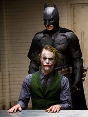 Heath Ledger (The Joker) is shown in a scene with Christian