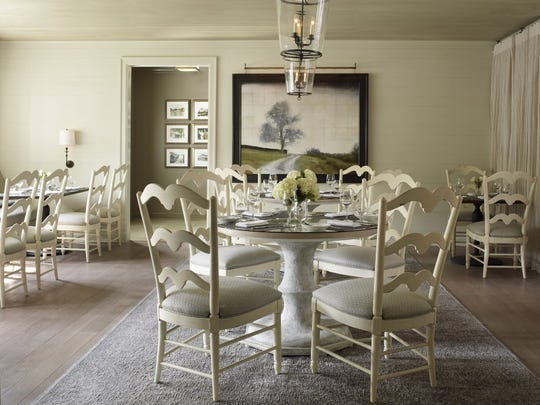 "Principal designer Ray Booth and senior designer Liz Bonesio Thompson wanted to ""keep the homey feel but modernize it."""