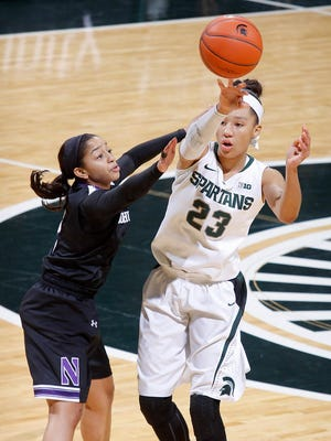 Michigan State's Aerial Powers (23) passes against Northwestern's Ashley Deary Sunday, Dec. 28, 2014, in East Lansing, Mich.