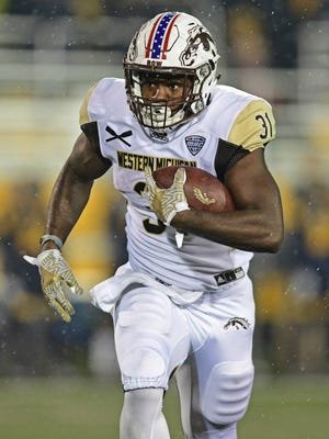 Western Michigan running back Jarvion Franklin carries the ball during the first quarter against Kent State.