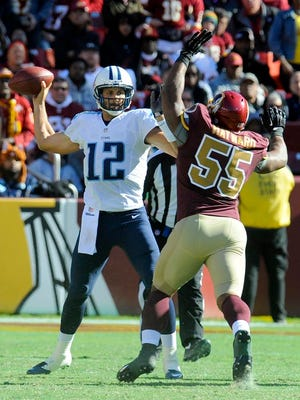 Titans quarterback Charlie Whitehurst passes under pressure from Redskins outside linebacker Adam Hayward during the second half in Landover, Md.