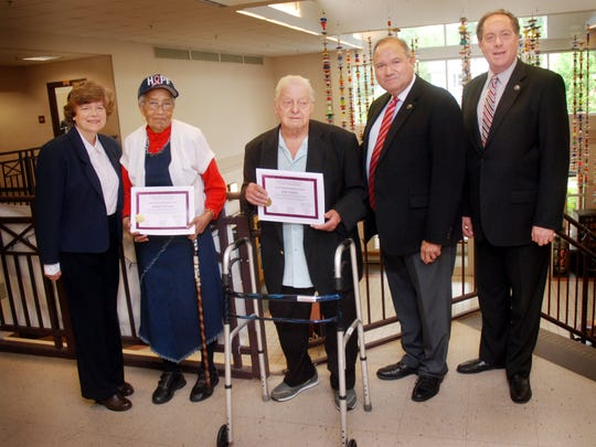 Union County Freeholder Chairman Bruce H. Bergen joined Freeholders Angel G. Estrada and Bette Jane Kowalski in presenting certificates to Marie Bethea of Plainfield and Joe Yorey of Cranford honoring them as Senior Volunteers of the Year for Older Americans Month.