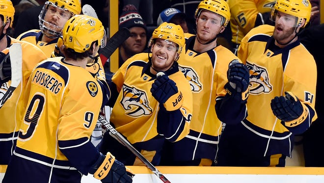 Predators forward Filip Forsberg (9) is congratulated by teammates after scoring in the second period Tuesday.