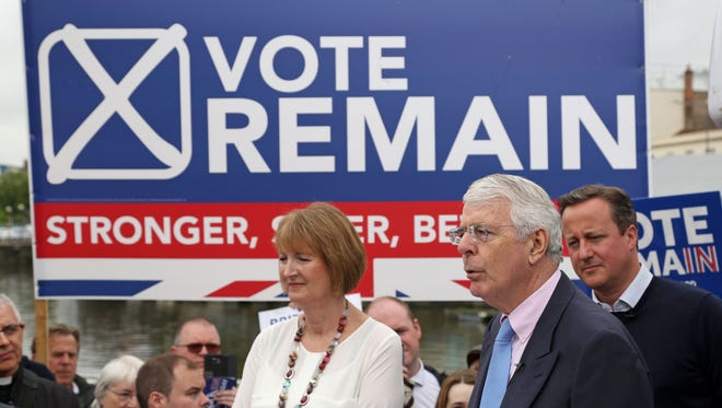 "British Prime Minister David Cameron (R) stands with Labour's Harriet Harman (L) as former Conservative Prime Minister John Major addresses pro-EU ""Vote Remain"" supporters during a rally in Bristol, south-west England, on June 22, 2016. (AFP PHOTO / Geoff CADDICK/AFP/Getty Images)"