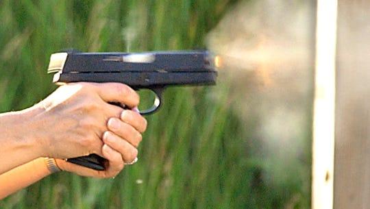 A gun discharging.