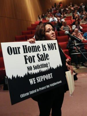 Claudia Gollub of Chestnut Ridge speaks during a public