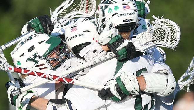 Yorktown's Steven Veteri (22) celebrates his first half goal against Garden City during the  state boys lacrosse semifinal at SUNY Albany June 7, 2017.