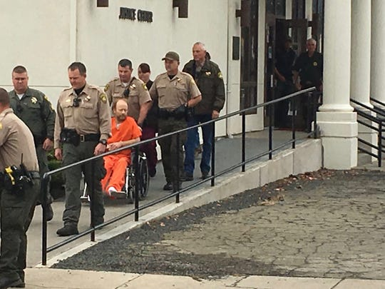Sean Longoria/Record SearchlightA deputy wheels Jack Lee Breiner, accused of killing Modoc County deputy Jack Hopkins, out of a courthouse after his arraignment in Alturas.