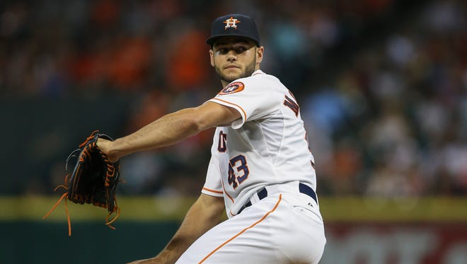 Houston Astros starting pitcher Lance McCullers pitches during the fourth inning against the Los Angeles Angels at Minute Maid Park.