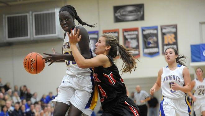 O'Gorman's #35 Sebastian Akoi drives to the basket against Brandon Valley's #34 Sydnie Buchheim during girls basketball action at O'Gorman High School in Sioux Falls, S.D., Tuesday, Dec. 15, 2015.