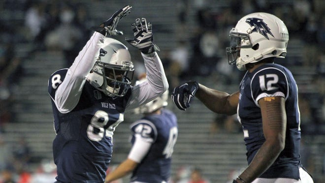 Receivers Jerico Richardson, left, and Hasaan Henderson are two of the 13 fifth-year seniors on the Wolf Pack's roster.