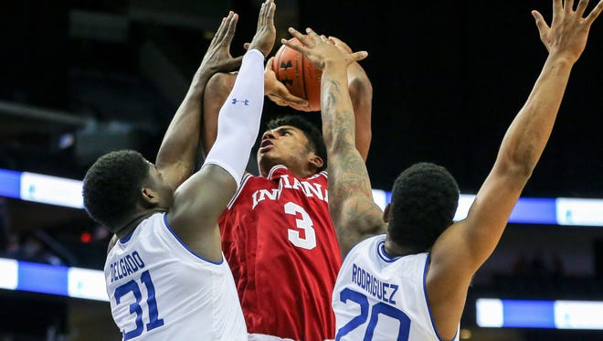 Indiana Hoosiers forward Justin Smith (3) shoots the ball as Seton Hall Pirates center Angel Delgado (31) and forward Desi Rodriguez (20) defend during the first half at Prudential Center.