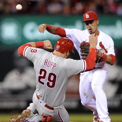 St. Louis Cardinals' Kolten Wong (16), right, completes the double play in the sixth inning Tuesday in St. Louis.