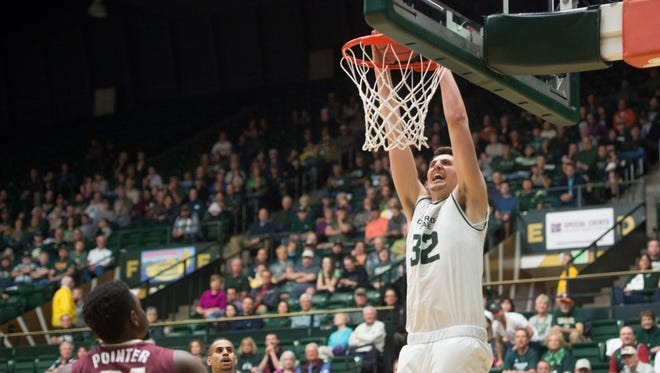 CSU forward Nico Carvacho dunks the ball for two of his eight points Tuesday night during the Rams' first-round win over College of Charleston in an NIT game at Moby Arena. CSU will host a second-round game this weekend against Cal State-Bakersfield.
