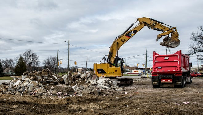 Rubble is cleared from the area where buildings were demolished Friday, Dec. 2, 2016 at 1918 Pine Grove Ave. in Port Huron. The property, which is owned by MDOT, is being cleared as part of the stalled Blue Water Bridge plaza expansion.
