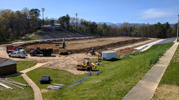 Work has begun on a new artificial turf field and track out at McDowell.