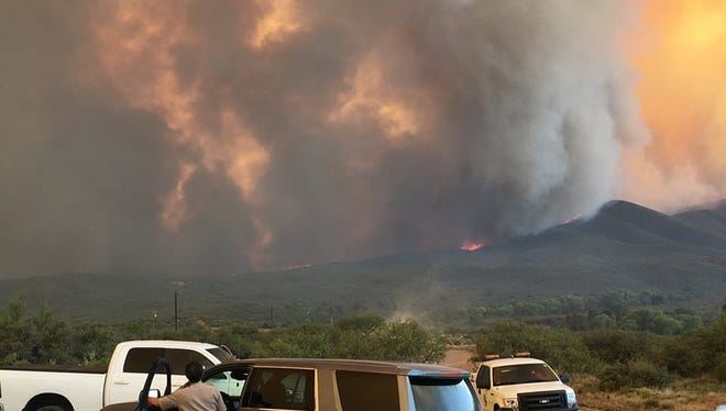 With conditions worsening for the Goodwin Fire, Gov. Doug Ducey declared a state of emergency in Yavapai County on June 28, 2017. The fire had grown to 21,000 acres and burned at least some structures in its widening path, officials said early in the day.