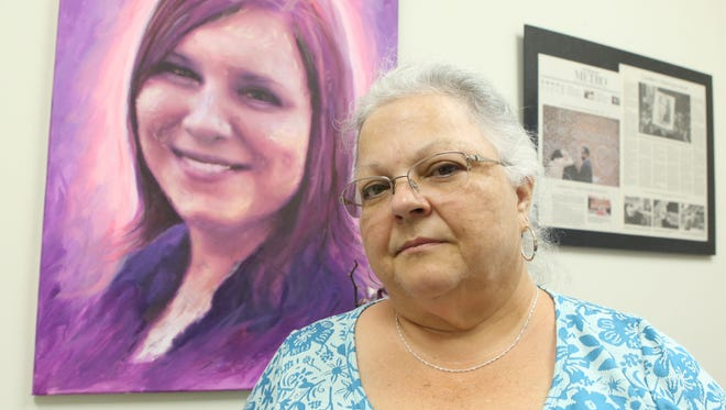 Susan Bro, the mother of Heather Heyer, who was killed in Charlottesville after being struck by a vehicle during the white nationalist riots, poses for a portrait in a room in Heyer's old law office, where her charitable foundation is now headquartered. The room, small but cheerful, features paintings of Heyer, tweets from Bernie Sanders in her honor, inspirational quotes and flowers. Everything is bedecked in purple, Heyer's favorite color.