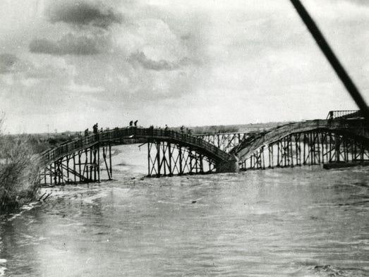 The Ash Avenue Bridge under construction, circa 1912.