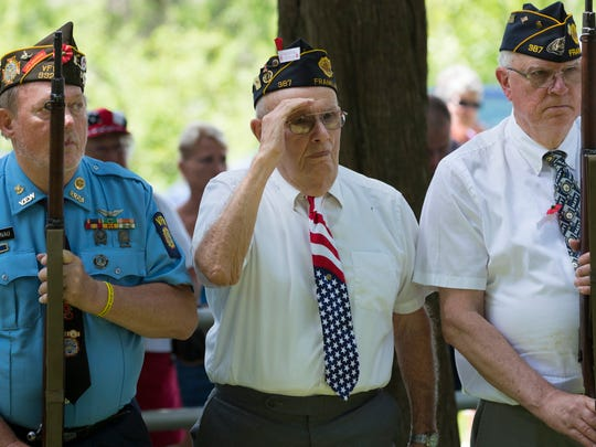 Veteran from the Howards Grove VFW and the American Legion Post in Franklin stand during the playing of Taps during the Town of Rhine's Memorial Day observance and picnic.