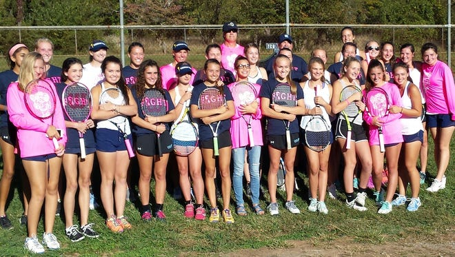 The Enka and Roberson tennis teams played a breast cancer awareness match Thursday in Skyland.
