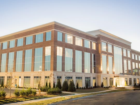 Professional photographer Trent Wallace uses natural light to enhance commercial real estate like the One Town Center office building in Berry Farms.