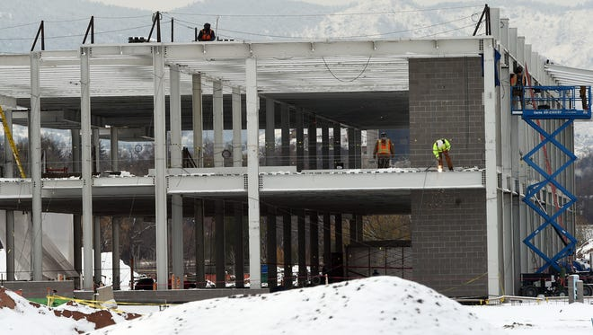 Steel workers weld the steel frame on a building at the Woodward site in northeast Fort Collins Nov. 13.