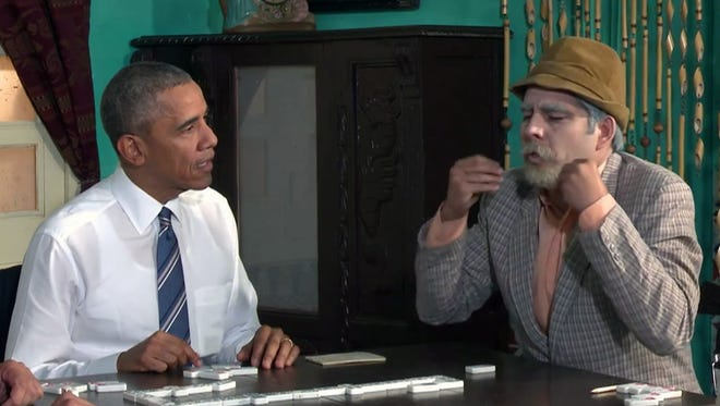 President Obama plays dominoes with Cuban TV character Pánfilo on March 23, 2016, during the president's trip to Havana. Pánfilo will be one of the featured stars in a new DISH Network channel featuring original Cuban programming.