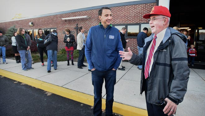 Republican candidate for Pennsylvania's 6th Congressional District Ryan Costello, and Republican candidate for Pennsylvania's 101st Legislative District Frank Ryan, get in last-minute campaigning at Sacred Heart Church in Cornwall Borough in the first hour of voting Tuesday, Nov. 8.