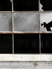 Many of the pane glass windows have been broken over the years by trespassers.