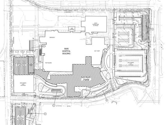 Mercy Medical Center plans to build a new inpatient tower, two parking garages and a power plant as part of a $500 million campus renovation. New facilities are shown in this map with diagonal lines.