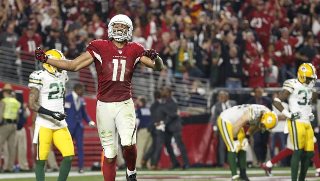 Arizona Cardinals wide receiver Larry Fitzgerald (11) celebrates after a 75-yard catch that set up the game-winning score against the Green Bay Packers during the game Saturday, Jan. 16, 2016, at the University of Phoenix Stadium.