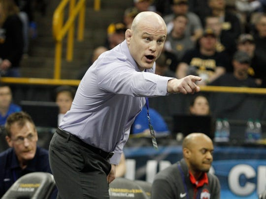 Coach Cael Sanderson is hoping to lead Penn State to another NCAA Division I national wrestling championship this weekend in Pittsburgh.