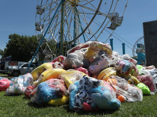 Prizes are bagged upped on the lawn Tuesday as workers get the Shasta District Fair ready to open on Wednesday.