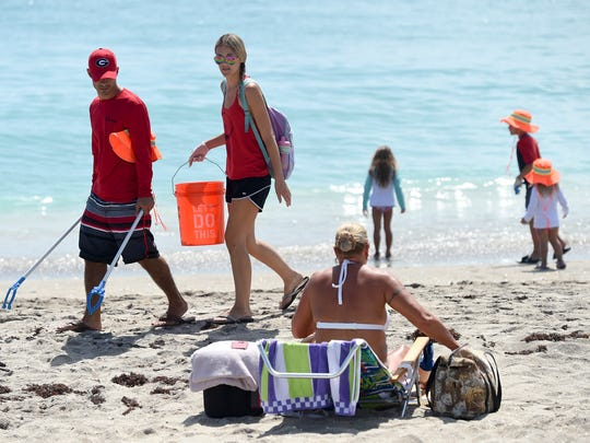 Martin and Palm Beach County residents rolled up their sleeves and gathered up garbage Saturday, July 7, 2018, during The Citizens for Clean Water (C4CW) Beach Cleanup at Stuart Beach on Hutchinson Island.