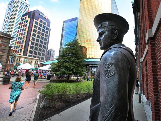 A life-size bronze statue of USS Indianapolis survivor James O'Donnell stands outside the City Market.