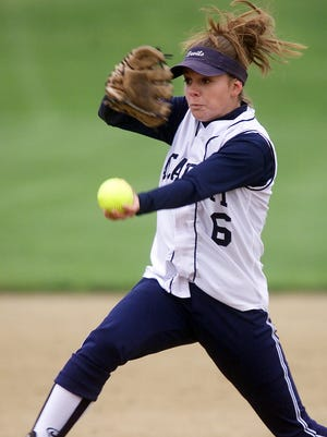 Martha Senko delivers a pitch for Elmira Free Academy in 2002. She had 69 wins and pitched six no-hitters during her EFA career.