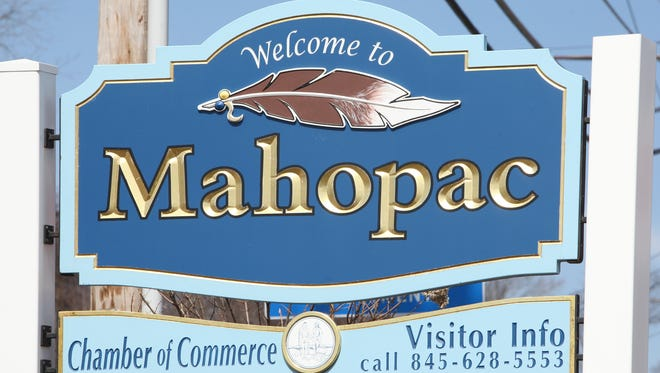 """A view of the """"Welcome to Mahopac"""" sign along Route 6 in Mahopac, photographed April 3, 2014."""